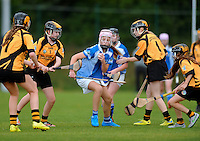 20 Aug 2016:  Caoimhe Lynskey, Galway, under pressure from Kilkenny. Camogie U14.  2016 Community Games National Festival.  Athlone Institute of Technology, Athlone, Co. Westmeath. Picture: Caroline Quinn
