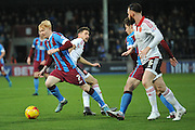 Luke Williams of Scunthorpe United makes his way up field  during the Sky Bet League 1 match between Scunthorpe United and Sheffield Utd at Glanford Park, Scunthorpe, England on 19 December 2015. Photo by Ian Lyall.