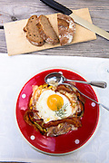 Swiss Rosti, fried egg and bacon at lunch at Gasthaus Hohwald hotel restaurant in Klosters, Graubunden region, Switzerland
