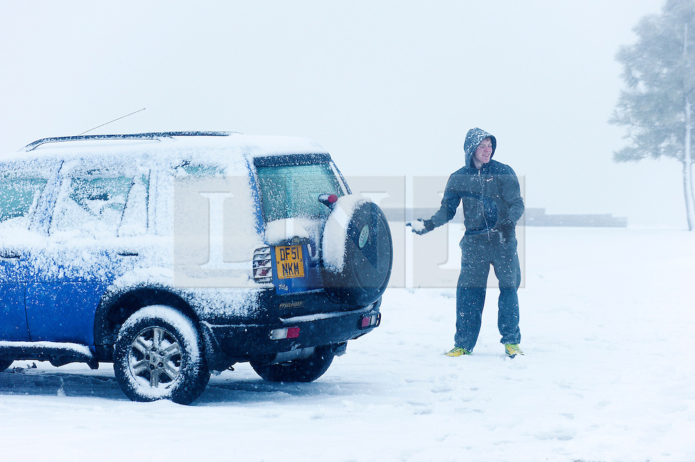 © Licensed to London News Pictures. 27/12/2014. Horseshoe Pass, Denbighshire, UK. People have snowball fights. Snow continues to fall on high ground in Wales. Photo credit: Graham M. Lawrence/LNP