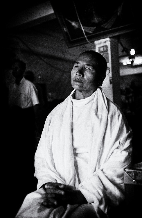 Daw Win Mya Mya, political prisoner, at the NLD (National League for Democracy) Headquarters in Yangon, 16th January 2012. Daw Win Mya Mya was released on January 13th, 2012 after serving 4.5 years of a 12 year sentence in prison. She had both arms broken during an ambush while traveling as part of Aung San Suu Kyi's convoy in Depsyinn, Sagaging Division, on the 30th May 2003. At the time she was both a Central Committee Member and Mandalay Division Member. After spending some months recovering in hospitals, she was arrested and imprisoned, becoming a political prisoner. Yangon (Rangoon) Myanmar (Burma) January 2012