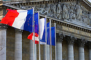 Flags fly on flagpoles outside Assemblée Nationale, Palais Bourbon, Central Paris, France