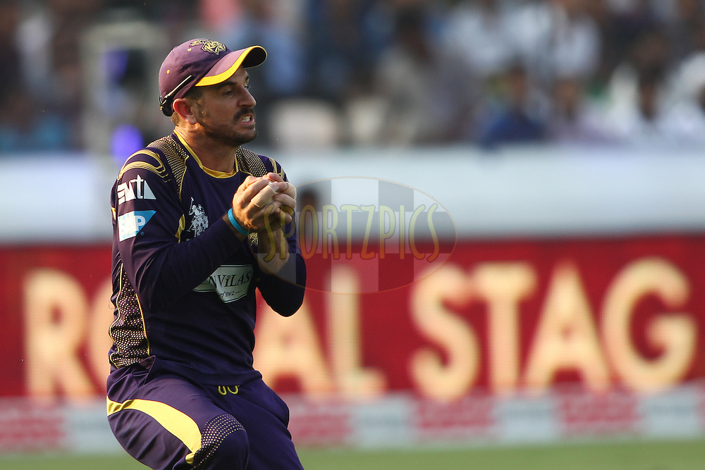 Ryan Ten Doeschate of the Kolkata Knight Riders takes the catch to get Travis Birt of the Hobart Hurricanes wicket during the first semi final match of the Oppo Champions League Twenty20 between the Kolkata Knight Riders and the Hobart Hurricanes held at the Rajiv Gandhi Cricket Stadium, Hyderabad, India on the 2nd October 2014<br /> <br /> Photo by:  Shaun Roy / Sportzpics/ CLT20<br /> <br /> <br /> Image use is subject to the terms and conditions as laid out by the BCCI/ CLT20.  The terms and conditions can be downloaded here:<br /> <br /> http://sportzpics.photoshelter.com/gallery/CLT20-Image-Terms-and-Conditions-2014/G0000IfNJn535VPU/C0000QhhKadWcjYs