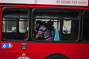 A London bus passenger on a hot bus during an unusual autumn heatwave on 13th September 2016, in the City of London, England.