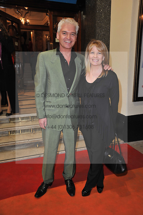 PHILLIP SCHOFIELD and his wife STEPHANIE arrives at the press night of the new Andrew Lloyd Webber  musical 'The Wizard of Oz' at The London Palladium, Argylle Street, London on 1st March 2011 followed by an aftershow party at One Marylebone, London NW1