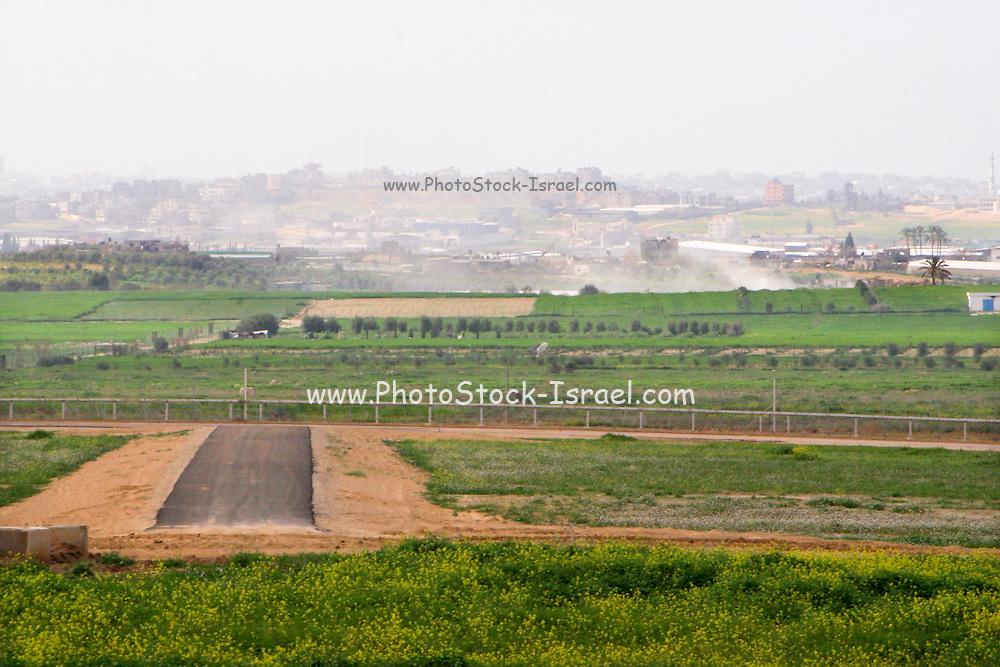 The Gaza-Israeli border at the north of Gaza strip. Smoke rises from Gaza as the falling of Qassam rockets continues. Feb 28, 2008.