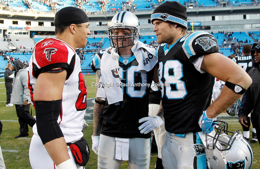 Atlanta Falcons tight end Tony Gonzalez (88) talks with Carolina Panthers tight end Jeremy Shockey (80) and Carolina Panthers tight end Greg Olsen (88) after the NFL week 14 football game against the Carolina Panthers on Sunday, December 11, 2011 in Charlotte, North Carolina. The Falcons won the game 31-23. ©Paul Anthony Spinelli