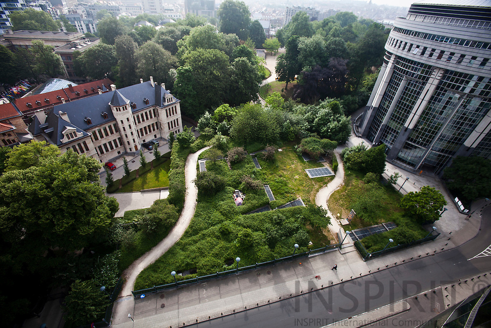 A homeless person have for several years lived in a tent (Left lower corner) with his dog and a cat in a small park between the European Parliament buildings in Brussels. MEPs and their assistants can follow his daily life from their office windows,  where this picture was taken 12 May 2011. To the the left the castle of the Representation of the Free State of Bavaria to the European Union and on the right is the Paul-Henri Spaak building where the MEP's hold their parlementarian sessions.   Photo: Erik Luntang / INSPIRIT Photo