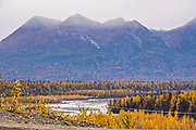 Termination dust, early snow, falls over the Alaska Range of mountains along the East Fork Chulitna River in Denali State Park near Cantwell, Alaska