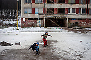 Children are ice sledding at the Lunik IX housing estate which is the home of the largest Roma community in Slovakia. The community is located a few kilometers away from the historical city centre, on the outskirts of the eastern Slovakian city of Kosice. Since the beginning of the 1980s a large number of the Roma residents living in the city and in nearby settlements have been moved to Lunik IX. Lunik IX has officially 6542 registered (12/2015) inhabitants and almost all of them are of Roma ethnicity.