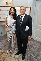 RENU MEHTA and GEORGE SOROS at the 4th Fortune Forum Summit held at The Dorchester Hotel, Park Lane, London on 4th December 2012.