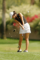 March 27, 2005; Rancho Mirage, CA, USA;  15 year old amateur Michelle Wie digs up a chunk of real estate on her approach shot on the 15th hole during the final round of the LPGA Kraft Nabisco golf tournament held at Mission Hills Country Club.  Wie shot a 1 under par 71 for the day and an even par 288 for the tournament and finished tied for 14th and won the award for low amateur.<br />Mandatory Credit: Photo by Darrell Miho <br />&copy; Copyright Darrell Miho