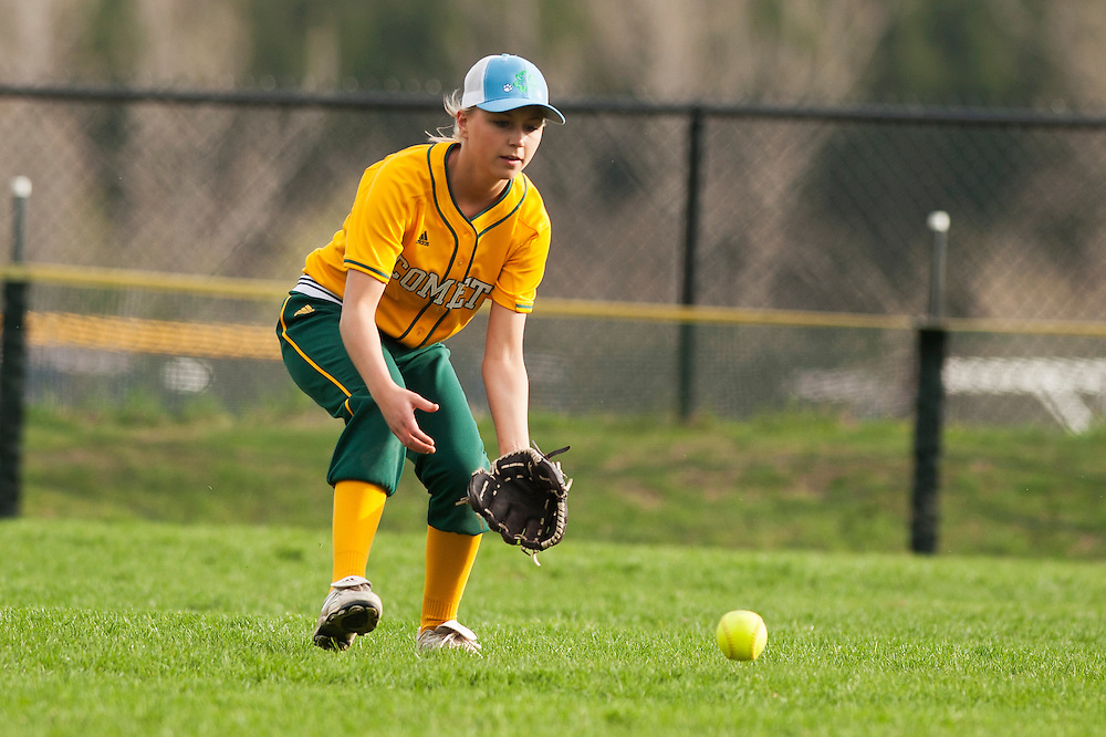 BFA's Samantha Dussault fields the ball in the outfield during the girls softball game between BFA-St. Albans and Mount Mansfield at MMU High School on Thursday afternoon May 8, 2014 in Jericho, Vermont. (BRIAN JENKINS, for the Free Press)