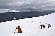Jan 18, 2017 - Orne Island, Antarctic Peninsula, Antarctica - Tourists hike Orne Island in Antarctica. The Russian research vessel Akademik Ioffe is seen in the distance.<br />  ©Ann Inger Johansson/zReportage/Exclusivexpix media
