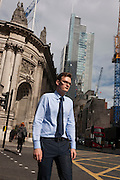 A businessman walks along Bishopsgate on 12th September, in the City of London, UK.