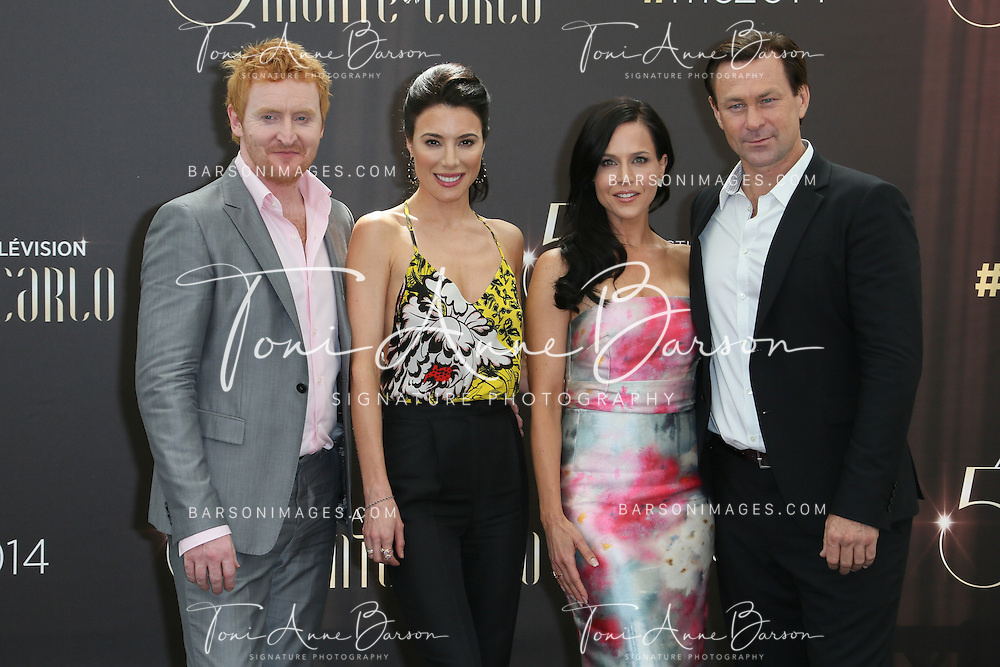 """MONTE-CARLO, MONACO - JUNE 09:  (L to R) Tony Curran, Jaime Murray, Julie Benz and Grant Bowler attend """"Defiance"""" photocall at the Grimaldi Forum on June 9, 2014 in Monte-Carlo, Monaco.  (Photo by Tony Barson/FilmMagic)"""
