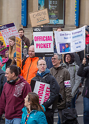 © Licensed to London News Pictures. 05/03/2018. Bristol, UK. University and College Union (UCU) nation wide strike. Members of the UCU trade union begin a second week of strikes at the University of Bristol, holding a picket and rally outside the university administrative centre Senate House, where some students have occupied part of the building, hanging a banner and waving a red flare from the roof. Lecturers and other university staff are holding an escalating wave of strikes over a four-week period at 61 universities across the country over a change in their pensions. The dispute centres on proposals to end the defined benefit element of the Universities Superannuation Scheme (USS) pension scheme. UCU says this would leave a typical lecturer almost £10,000 a year worse off in retirement than under the current set-up. Photo credit: Simon Chapman/LNP