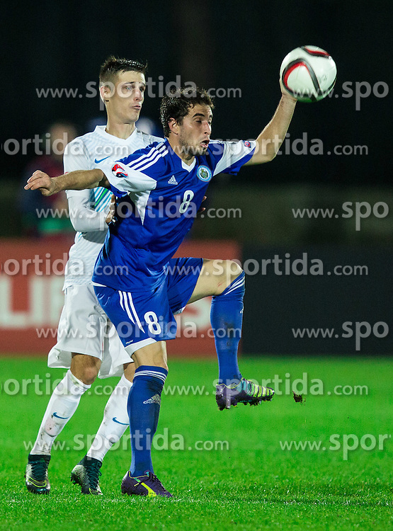 Andraz Struna of Slovenia vs Jose Hirsch of San Marino during football match between National teams of San Marino and Slovenia in Group E of EURO 2016 Qualifications, on October 12, 2015 in Stadio Olimpico Serravalle, Republic of San Marino. Photo by Vid Ponikvar / Sportida