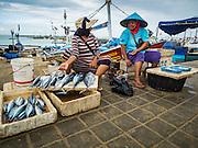 18 JULY 2016 - KUTA, BALI, INDONESIA:  Women sell fish at Pasar Ikan pantai Kedonganan, a fishing pier and market in Kuta, Bali.   PHOTO BY JACK KURTZ