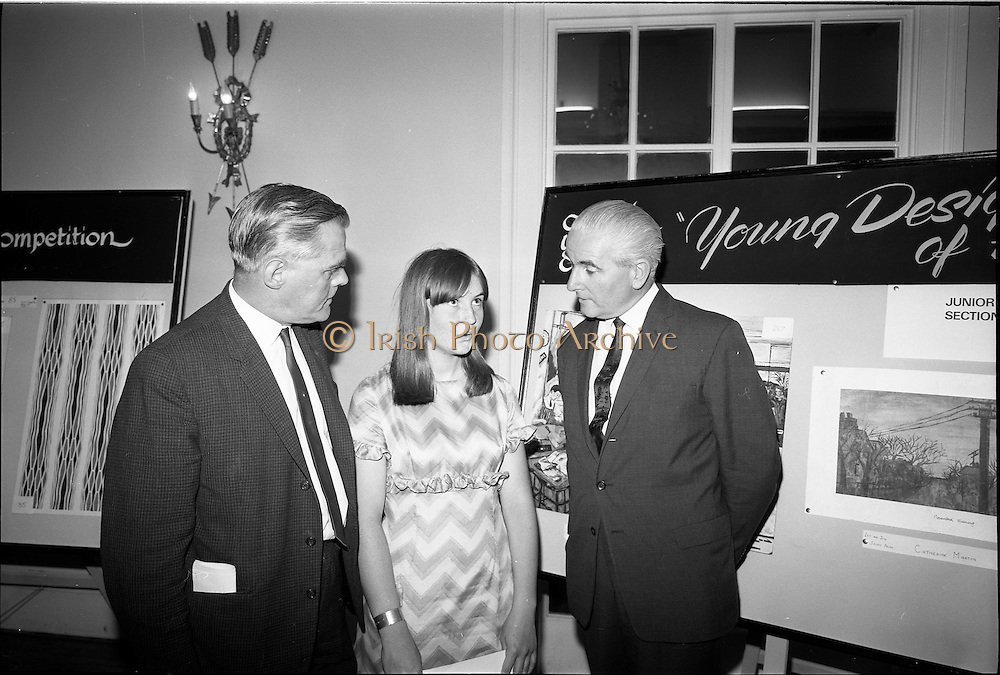 "28/06/1967<br /> 06/28/1967<br /> 28 June 1967<br /> Presentation of prizes at Navan Carpets ""Young Designer of the Year"" reception in the Royal Hibernian Hotel, Dublin. Image shows (l-r): Mr. Allan Mallinson, Managing Director, Navan Carpets Ltd.; Miss Catherine Martin, Technical School Navan, who won joint 1st and 2nd in the Junior Section and Mr James White, Director, National Gallery of Ireland."