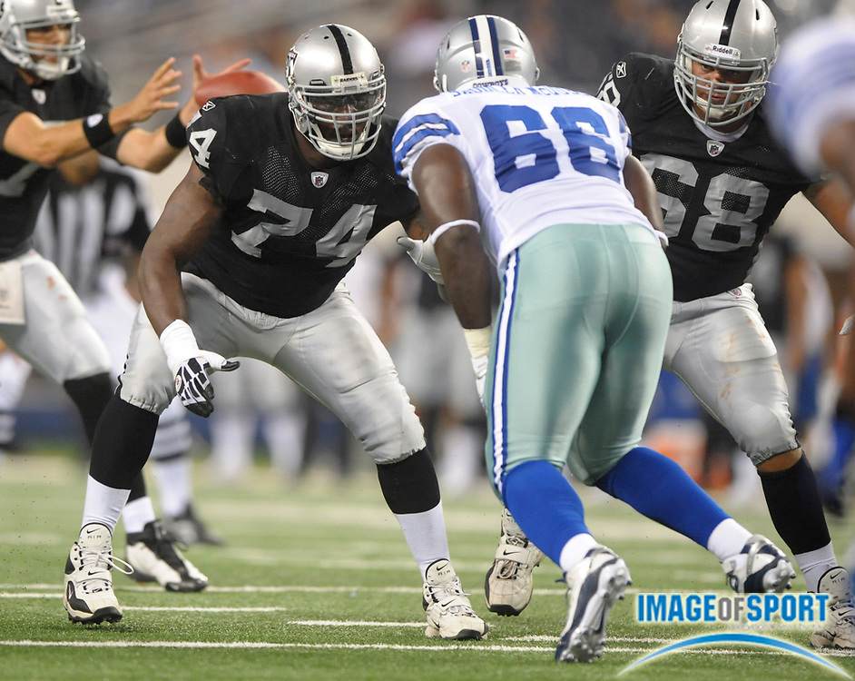 Aug 12, 2010; Arlington, TX, USA; Oakland Raiders rookie guard Bruce Campbell (74) and rookie tackle Jared Veldheer (68) defend against Dallas Cowboys defensive lineman Jimmy Saddler-McQueen (68) during the preseason game at Cowboys Stadium. The Raiders defeated the Cowboys 17-9. Photo by Image of Sport