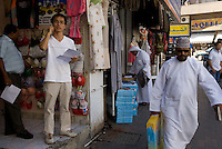Shop keepers in old Dubai. Dubai, one of the seven emirates and the most populous of the United Arab Emirates sits on the southern coast of the Persian gulf.