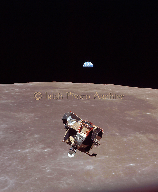 Beautiful Half-Illuminated Earth Backdrops the Liftoff of the NASA Apollo 11 Lunar Module ('Eagle') From the Moon's Surface, July 21, 1969 As Seen From the Orbiting NASA Apollo 11 Command and Service Modules ('Columbia')