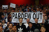 Newcastle United fans show their frustration with Alan Pardew Manager of Newcastle United by hoLding up a banner that reads 'PARDEW OUT' during the Barclays Premier League match at the Emirates Stadium, London<br /> Picture by David Horn/Focus Images Ltd +44 7545 970036<br /> 28/04/2014