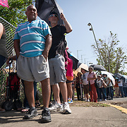 OCTOBER 20 - PONCE, PUERTO RICO - <br /> Residents of Ponce, wait in a long line to receive donated water and MRE's in a distribution center in a sports arena in the Southern town of Ponce, the 2nd largest city in Puerto Rico. <br /> (Photo by Angel Valentin/Freelance)