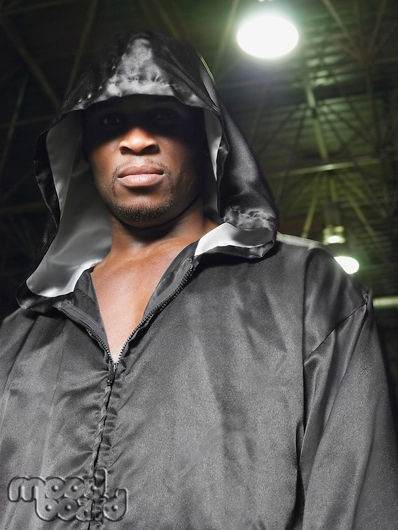 Boxer wearing robe with hood up portrait