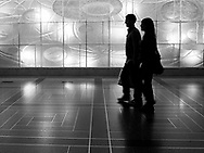 Silhouettes in the concourse of Rockefeller Center, New York City.