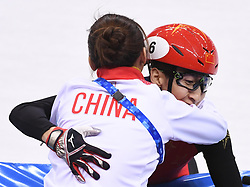 PYEONGCHANG, Feb. 22, 2018  Wu Dajing (R) of China celebrates victory with Li Yan,  head coach of China's short track speed skating team, after winning men's 500m final of short track speed skating at the 2018 PyeongChang Winter Olympic Games at Gangneung Ice Arena, Gangneung, South Korea, Feb. 22, 2018. Wu Dajing claimed gold medal in a time of 0:39.584 and set new world record. (Credit Image: © Ju Huanzong/Xinhua via ZUMA Wire)