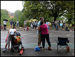 Image ©Licensed to i-Images Picture Agency. 07/07/2014. London, United Kingdom. Spectors wait in the rain for Riders to pass through Woodford Green in London on their way to the Mall on stage 3 of the final UK leg of Tour de France . Picture by Andrew Parsons / i-Images