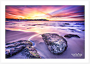 A gorgeous autumn sunrise on a perfectly calm morning at Bondi Beach [Bondi, NSW, Australia]<br />