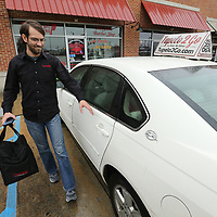 Blake Richardson, a driver for Tupelo 2 Go, walks out a customers order from the Neon Pig to put in his car. Next month, Tupelo 2 Go will celebrate its two-year anniversary. They have expanded their service to include the Mooreville and Saltillo areas and increased their delivery drivers from 4 to 30. Feburary will also be Richardson's two anniversary with the delivery business.