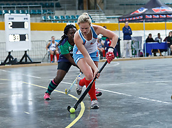 Paige Phillips of WP Peninsula controls the ball, under pressure from Confidence Mashua of KZN Inland during the interprovincial indoor hockey tournament held at the Bellville Velodrome, Cape Town, on the 13th October 2016. Photo by: John Tee/RealTime Images