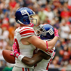 October 10, 2010; Houston, TX USA; New York Giants wide receiver Hakeem Nicks (88) celebrates with tight end Kevin Boss (89) following a touchdown during a game against the Houston Texans at Reliant Stadium. The Giants defeated the Texans 34-10. Mandatory Credit: Derick E. Hingle