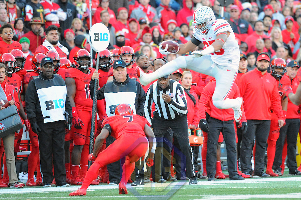 COLLEGE PARK, MD - NOVEMBER 12: Ohio State Buckeyes tight end Marcus Baugh (85) leaps over Maryland Terrapins defensive back JC Jackson (7) after a second quarter reception on November 12, 2016, at Capital One Field in College Park, MD.   (Photo by Mark Goldman/Icon Sportswire)