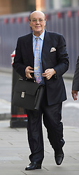 © London News Pictures. 14/08/2012. London, UK. Cypriot businessman Asil Nadir arriving at Central Criminal Court, Old Bailey, in London on August 14, 2012 where the jury is currently considering a verdict  in the Polly Peck fraud case. Nadir, who fled to Cyprus in 1993 after the charges were first brought, is accused of £34m fraud at his firm Polly Peck. Photo credit : Ben Cawthra/LNP