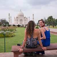 Two voyagers from Semester at Sea's Spring 2014 voyage take time to soak in the beauty of the Taj Mahal in Agra, India.