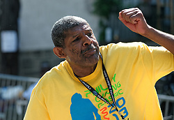 Melvin Moore has been volunteering at Philadelphia's bike race for 27 years (he missed one year) and his cheering approach was so admirable that fans were calling him over from the sideline to shake his hand. Scenes from the 2011-2014 Philadelphia International Bicyling Classic #ManayunkWall Bike Race, traditionally held in the first week of June. (photo by Bastiaan Slabbers/BasSlabbers.com)<br /> <br /> For license options of Philadelphia International Cycling Classic related imagery please visit my editoiral stock portfolio at Getty Images/iStock.com: istockphoto.com/portfolio/basslabbers