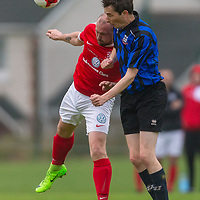 Bridge United's Jonathan Downes and Newmarket Celtic's Gary Higgins both jump for the ball