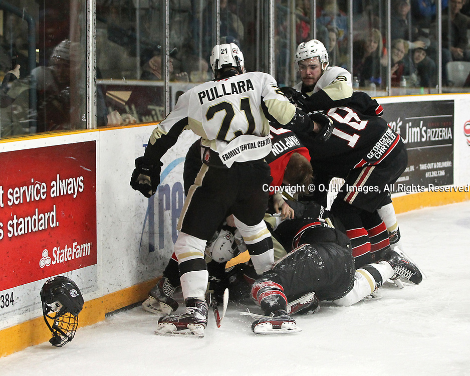 TRENTON, ON  - APR 15,  2017: Ontario Junior Hockey League, Championship Series. Georgetown Raiders vs the Trenton Golden Hawks in Game 2 of the Buckland Cup Final. Jonathan Hampton #71 of the Georgetown Raiders becomes involved in an altercation with Jeremy Pullara #21 of the Trenton Golden Hawks as other players join in during the third period. Hampton's helmet gets torn off during the altercation.<br /> (Photo by Tim Bates / OJHL Images)
