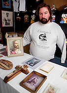 ALLENTOWN, PA - JANUARY 19:  Bud Carson poses with some of his Jesus shrine items, which are for sale at his wrestling memorabilia store January 19, 2005, in Allentown, Pennsylvania.  (Photo by William Thomas Cain)