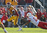 November 06 2010: Iowa State Cyclones running back Alexander Robinson (33) runs away from a diving tackle by Nebraska Cornhuskers safety Courtney Osborne (12) during the first half of the NCAA football game between the Nebraska Cornhuskers and the Iowa State Cyclones at Jack Trice Stadium in Ames, Iowa on Saturday November 6, 2010. Nebraska defeated Iowa State 31-30.