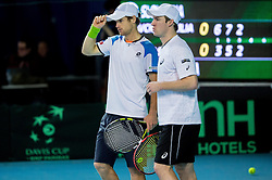 Blaz Kavcic and Grega Zemlja of Slovenia (white) plays doubles against Joao Sousa and Gastao Elias of Portugal (red) during 3rd match of Davis cup Slovenia vs. Portugal on February 1, 2014 in Kranj, Slovenia. Photo by Vid Ponikvar / Sportida