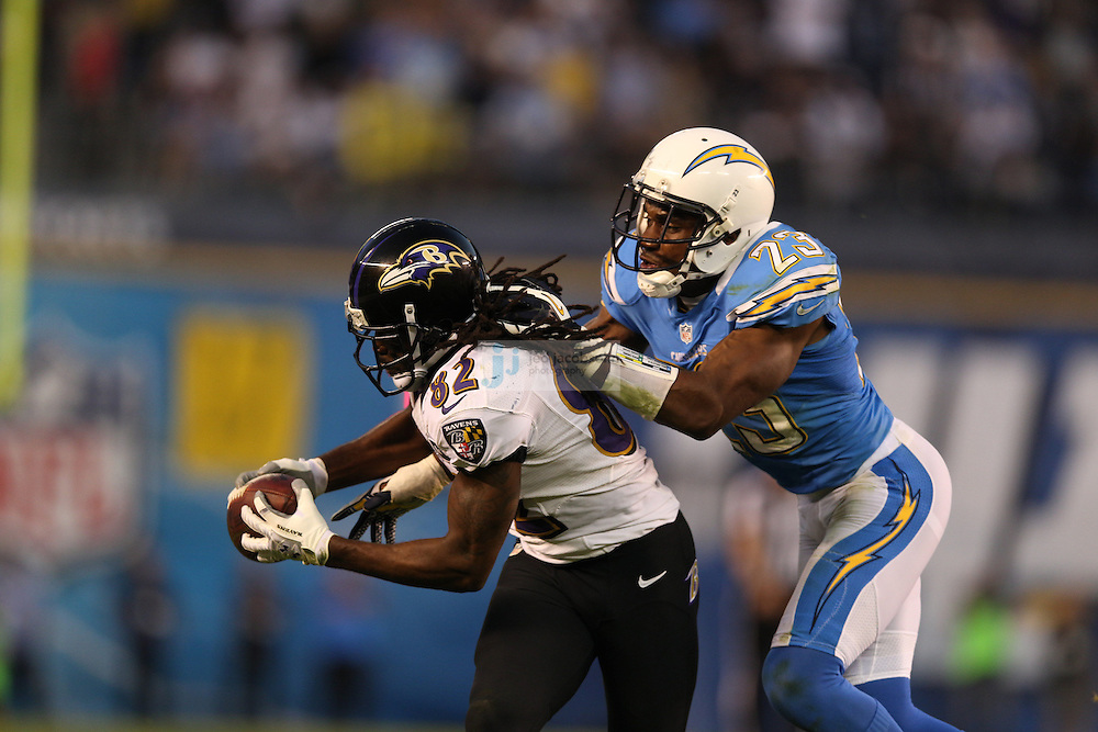 Baltimore Ravens wide receiver Torrey Smith (82) catches a pass against the San Diego Chargers cornerback Quentin Jammer (23)  during an NFL game on Sunday, November 25, 2012 in San Diego, CA.  (Photo by Jed Jacobsohn)