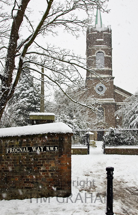 Snow covered St John At Hampstead Parish Church and graveyard, Hampstead, North London, UK