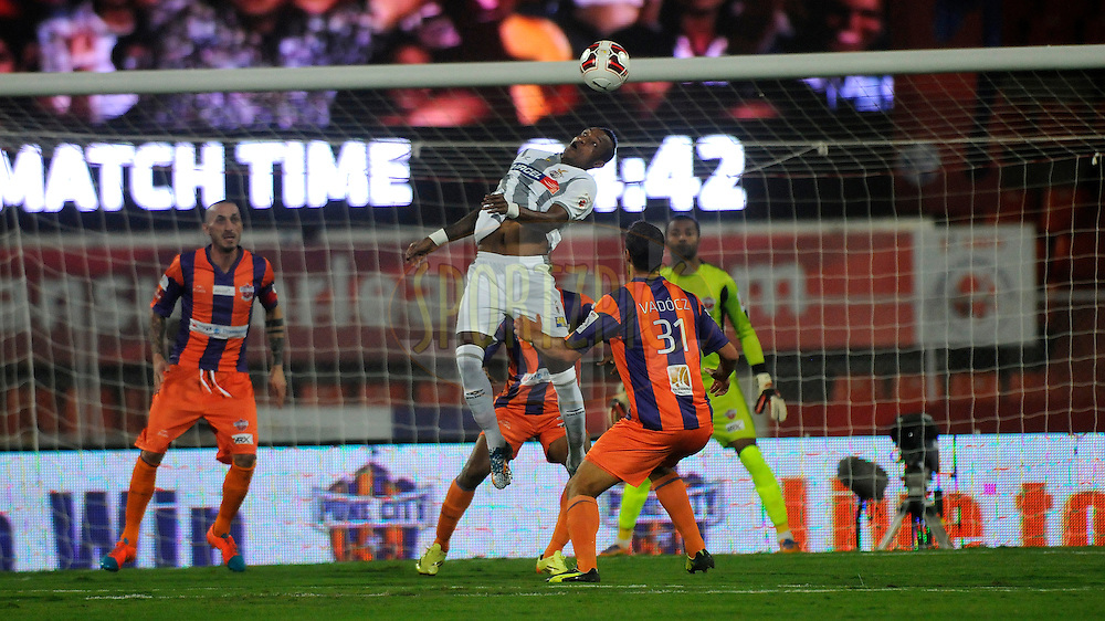 Fikru Tefera Lemessa of Atletico de Kolkata takes a header during match 44 of the Hero Indian Super League between FC Pune City and Atletico de Kolkata FC held at the Shree Shiv Chhatrapati Sports Complex Stadium, Pune, India on the 29th November 2014.<br /> <br /> Photo by:  Pal Pillai/ ISL/ SPORTZPICS