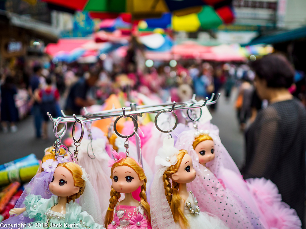14 JUNE 2018 - SEOUL, SOUTH KOREA: Dolls for sale in Namdaemun Market. Namdaemun Market is one of the oldest continually running markets in South Korea, and one of the largest retail markets in Seoul. The streets in which the market is located were built in a time when cars were not prevalent, so the market itself is not accessible by car. The main methods of transporting goods into and out of the market are by motorcycle and hand-drawn carts. It occupies many city blocks, which are blocked off from most car traffic due to the prevalence of parking congestion in the area.       PHOTO BY JACK KURTZ